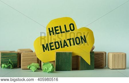 Hello Mediation - Words On Yellow Paper Against A Background Of Scattered Wooden Cubes On A Mint Bac