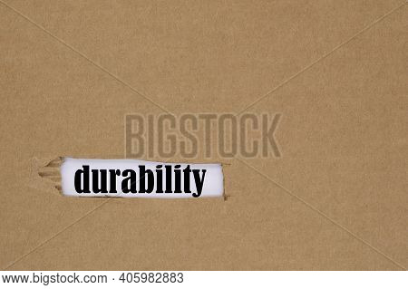 The Word Durability Is Written In A Hole In The Cardboard. The Concept Of Durability