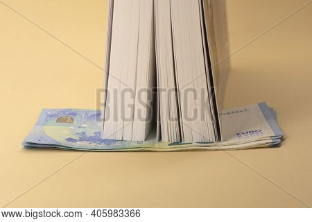 Banknotes Of Euro Money Hidden And The Book. Budget Saving. Time To Get Saved Money In Times Of Unem