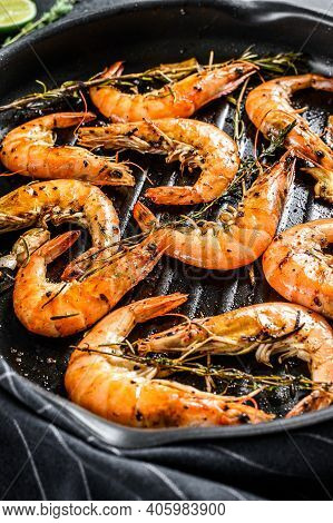 Grilled Giant Langoustine Shrimps, Prawns In A Frying Pan. Black Background. Top View