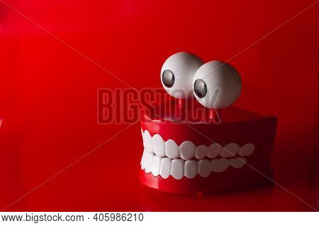 Clockwork Jaw With White Teeth On A Red Background