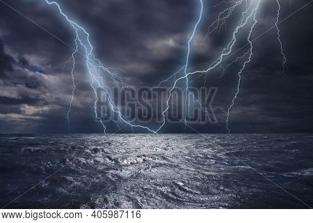 Lightning Strike Over The Ocean. Bolt Of Lightning Over Stormy Dark Sea During A Thunder-storm With