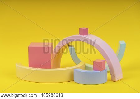 Wooden Geometric Shapes Forms Colorful Figures Composition On Yellow Background