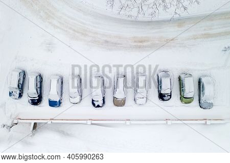 Snow-covered Cars In The Parking Lot Top View From The Throne.