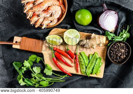Ingredients For Cooking Tom Kha Gai. Thai Chicken Soup In Coconut Milk. Black Background. Top View