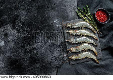 Fresh Raw Giant Langoustine Shrimp. Black Background. Top View. Copy Space