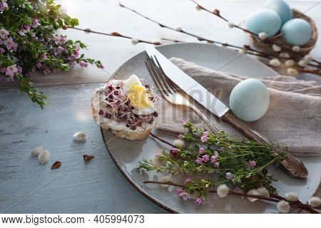 Floral Easter Place Setting For A Breakfast With Cream Cheese And Radish Seeds On Gray Vintage Wood.