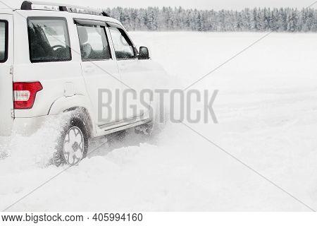 Saint-petersburg, Russia- 01.07.2021: Modern White Suv Car Uaz Patriot  On Snowy Road When Driving T