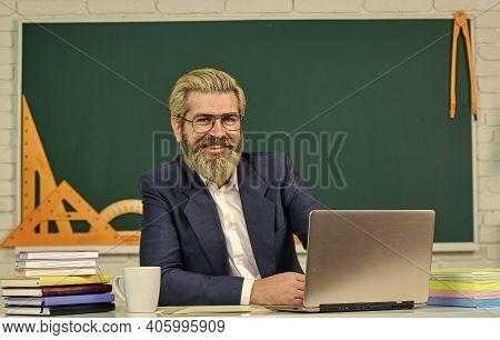 Teaching Profession. Happy School Teacher. Bearded Man Teach In Class. Private Teaching. Teaching An