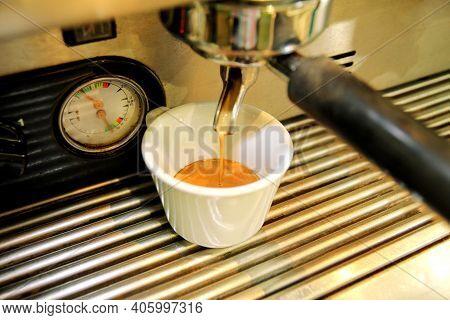 Coffee Maker. Close-up White Coffee Cup. Espresso Machine. A Professional Coffee Maker In A Cafe. Th