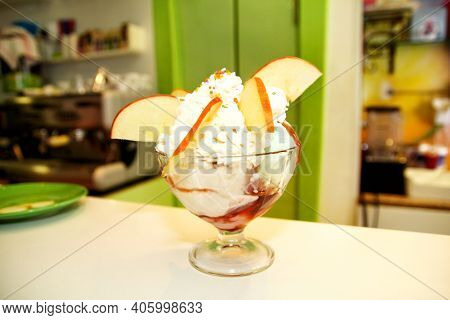 Ice Cream Cup With Forest Fruit And Candy Melts In A High Glass Beaker, Closeup. Handmade Ice Cream
