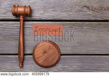 Judge Gavel And Innocent Verdict. Browm Wooden Hammer.
