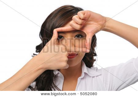 A Pretty Young Asian Woman With Framing Hands