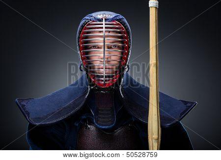 Portrait of kendoka with shinai. Asian martial arts concept