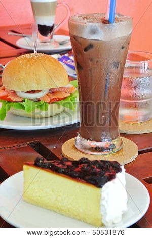 Blue Berry Cheese Cake And Burger And Coffee In Breakfast