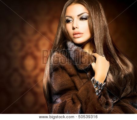 Beauty Fashion Model Girl in Mink Fur Coat. Beautiful Woman in Luxury Brown Fur Jacket . Winter Fashion