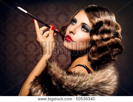 Retro Woman Portrait. Beautiful Woman with Mouthpiece. Cigarette. Smoking Lady. Vintage Styled Black and White Photo. Old Fashioned Makeup and Finger Wave Hairstyle. 20's or 30's style.  poster