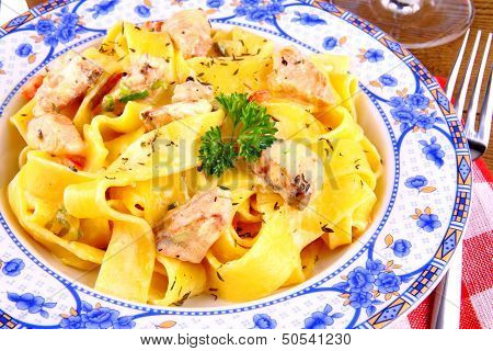 Salmon fish with taglateli and fork close up poster