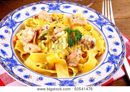 Salmon fish with taglatelle and fork top view poster
