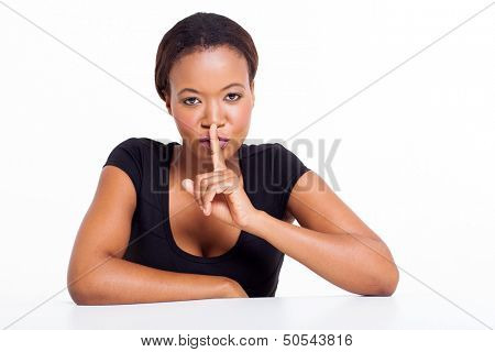 african american woman saying shhh isolated on white background
