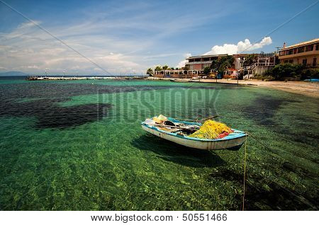 Boat Moored On The Beach