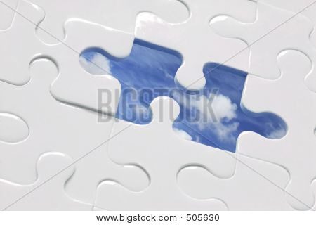 white jigsaw with piece missing and sky background; cp for missing piece included poster