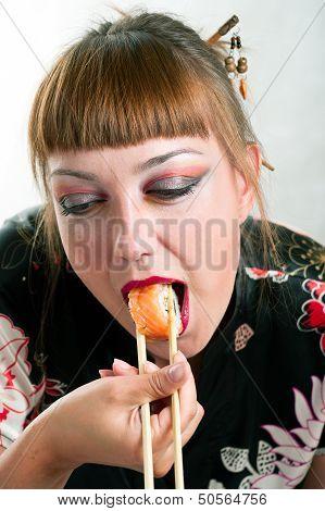 Woman Eating Rolls