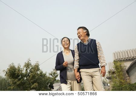 Senior couple going for a stroll in Beijing, holding hands