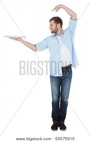 Smiling model holding laptop on right hand with flair on white background