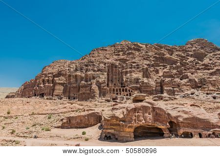 PETRA, JORDAN - MAY 10: tourists visiting Royal tombs in nabatean petra jordan middle east on may 10th, 2013. UNESCO World Heritage Site built around 309 BC, is identified as the biblical Mount Hor