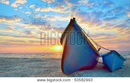 blue fisherman boats and sunrise