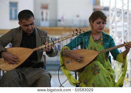 ZAGREB,CROATIA - JULY 17: Members of Music Society Payiz from Kurdistan, Irak in Kurdish national costume during the 47th International Folklore Festival in center of Zagreb, Croatia on July 17,2013
