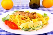 Grilled salmon fillet taglateli lemon and herbs close up poster