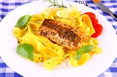 Grilled salmon fillet with taglateli lemon and herbs top view poster