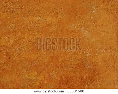 Background of rough cement wall painted ochre