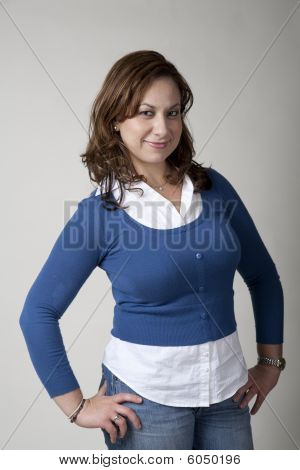 Woman In Blue With Hands On Hips