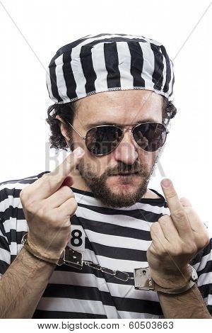 Desperate, portrait of a man prisoner in prison garb, over white background