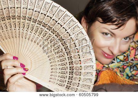 Joyful Caucasian Woman With A Fan