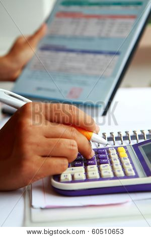 Business Concept Hand Analyzing Financial Data