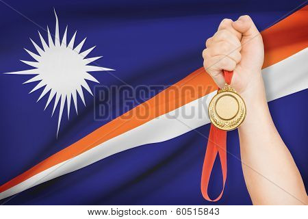 Medal In Hand With Flag On Background - Marshall Islands