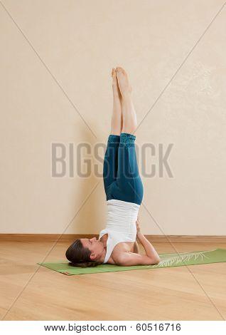 Caucasian woman is practicing yoga at studio (hasta uttanasana) poster