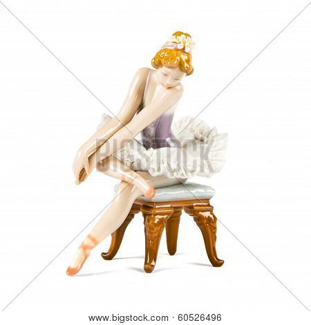 Porcelain Doll. Dancing Girl Over White Background