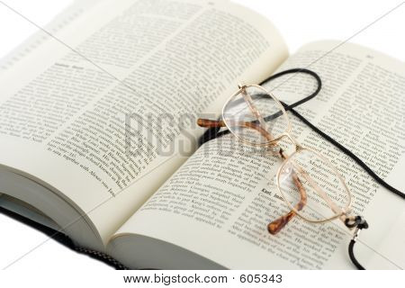 Open Book And Glasses On It