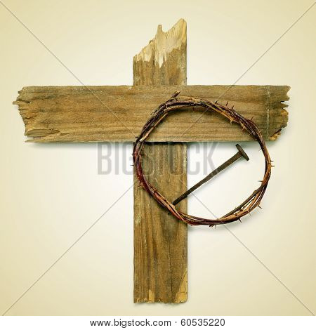 the Holy Cross, the crown of thorns and a nail depicting the passion of Jesus Christ on a beige background, with a retro effect