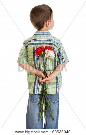 Little boy hiding carnations behind itself