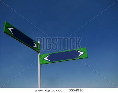 Direction Signs On Blue Background