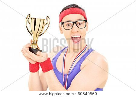 Young male champion holding a trophy isolated on white background