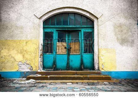 Old Industrial Building In A Closed Wooden Door