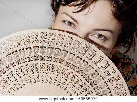 Beautiful Woman Partly Hidden Behind A Fan