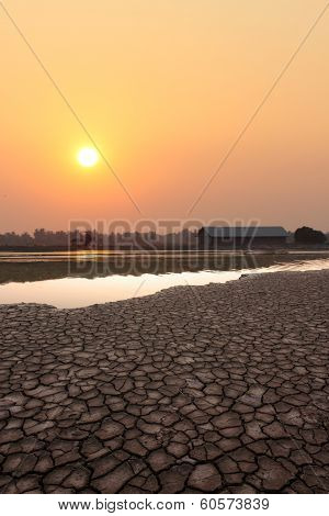 Dry Land And Lake In Sun Set